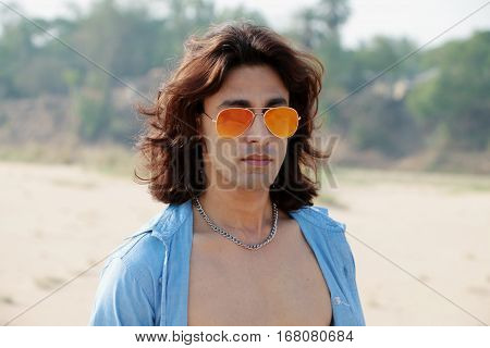Passions Instinct Beautiful Bold sexy shirtless sizzling long hair guy wearing orange sunglaaa