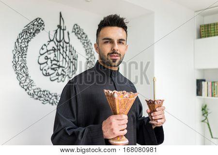 Arabian man with traditional parfume