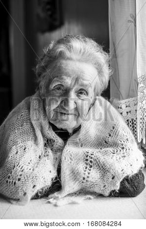 Black and white portrait of an old woman. Elderly.