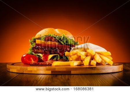 Big burger, French fries and vegetables