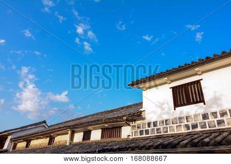 Historic buildings at Bikan quarter in Kurashiki under blue sky