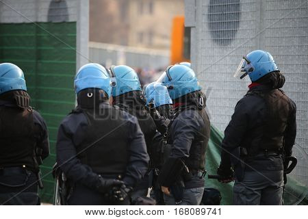Policeman With Riot Gear  And Helmets During The Uprising Town