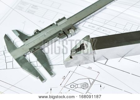 Caliper and metal detail pattern with blueprint for cnc metalworking