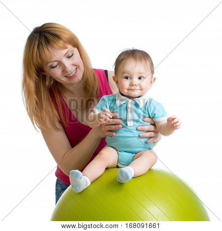Mother with happy baby doing exercises with gymnastic ball. Concept of caring for the children health.