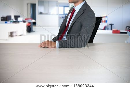 Man leaning on an empty desk