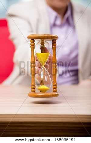Hourglasses in business concept in time concept