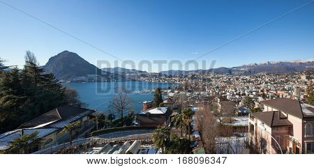 Panoramic view of Lugano city and the mountains in background, Ticino, Switzerland