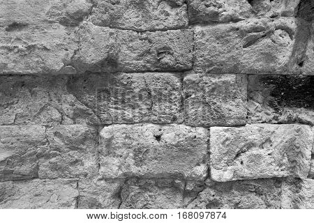 background and old texture of an ancient wall from a stone brick of monochrome tone