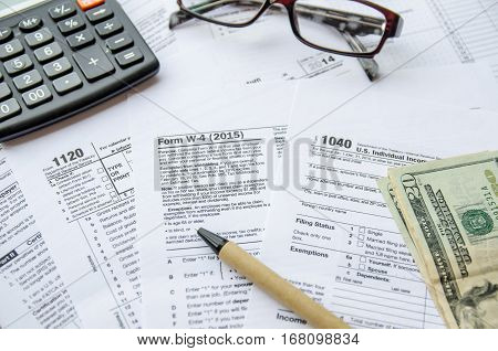 Tax Form W4 1120 1040 close up
