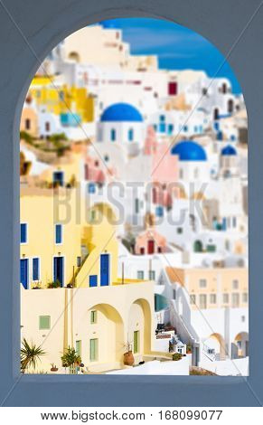 Oia village in window frame, view of Ia town, Santorini island, Greece