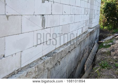 House wall ready for waterproofing foundation with insulation. Insulating Exterior Foundation Walls.