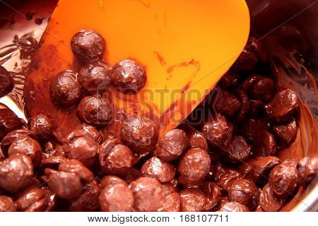 Melted the chocolate balls and the stirring orange plastic shovel