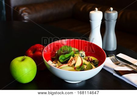 Fresh home-made delicious Waldorf salad in red bowl