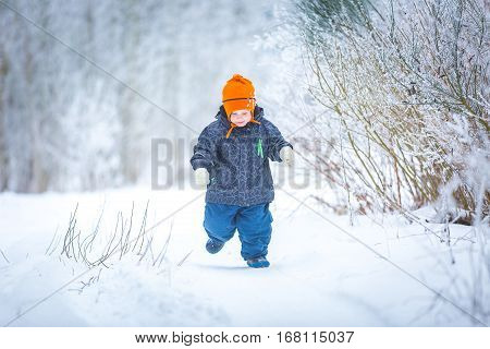 Happy Boy Playing Outdoor In Winter