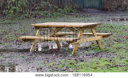 Wooden Picknickplace On A Green Field