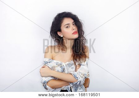 Beauty Portrait Of Young Adorable Fresh Looking Brunette Woman With Curly Hair Crossed Hands Inquiri