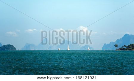 Sailing ships on the horizon. Ships far on the horizon