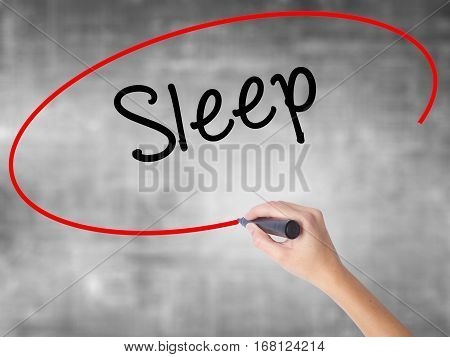 Woman Hand Writing Sleep With Black Marker Over Transparent Board