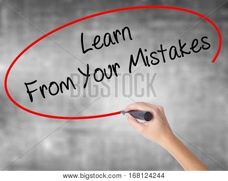Woman Hand Writing Learn From Your Mistakes  With Black Marker Over Transparent Board