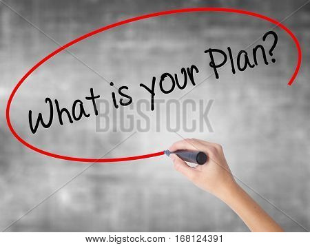 Woman Hand Writing What Is Your Plan? With Black Marker Over Transparent Board