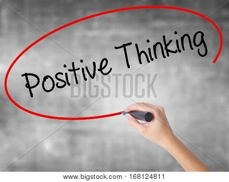 Woman Hand Writing Positive Thinking With Black Marker Over Transparent Board