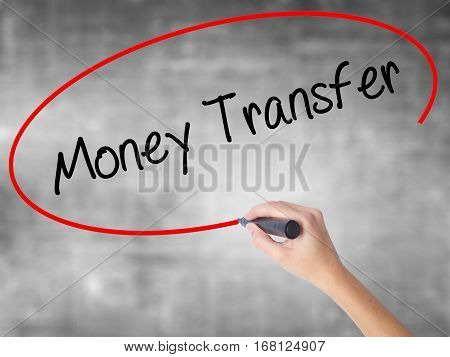 Woman Hand Writing Money Transfer  With Black Marker Over Transparent Board