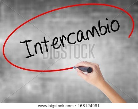 "Woman Hand Writing ""intercambio"" (in Portuguese - Student Exchange Program)  With Black Ma"