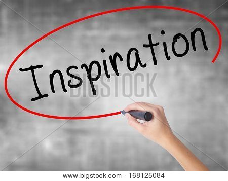 Woman Hand Writing Inspiration With Black Marker Over Transparent Board
