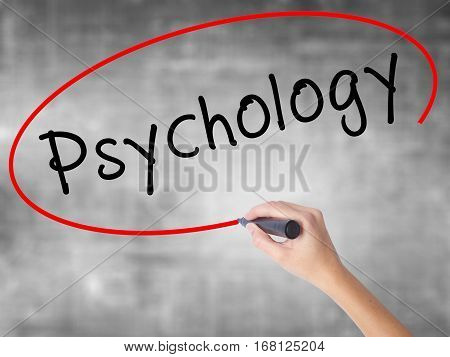 Woman Hand Writing Psychology With Black Marker Over Transparent Board