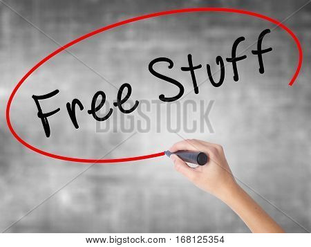 Woman Hand Writing Free Stuff With Black Marker Over Transparent Board