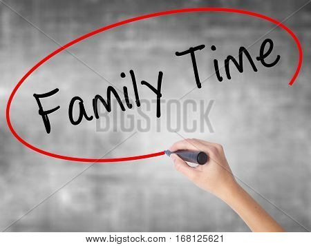 Woman Hand Writing Family Time With Black Marker Over Transparent Board