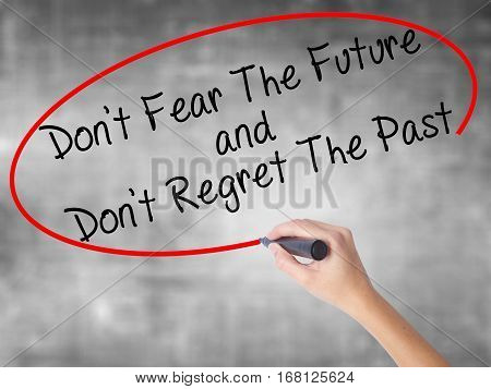 Woman Hand Writing Don't Fear The Future And Don't Regret The Past With Black Marker Over Transparen