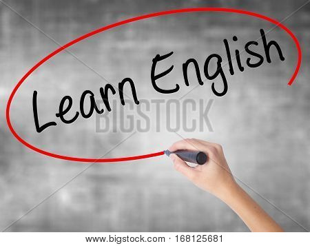 Woman Hand Writing Learn English With Black Marker Over Transparent Board