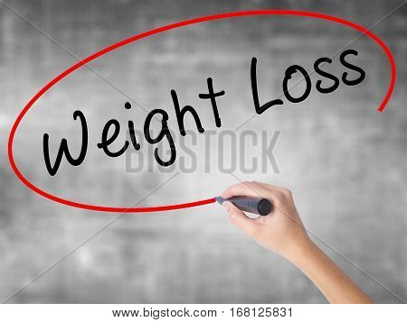 Woman Hand Writing Weight Loss With Black Marker Over Transparent Board