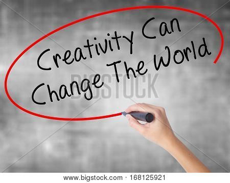 Woman Hand Writing Creativity Can Change The World With Black Marker Over Transparent Board