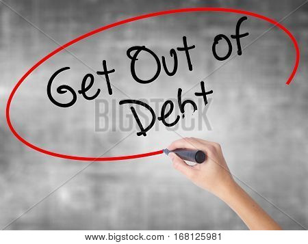 Woman Hand Writing Get Out Of Debt With Black Marker Over Transparent Board