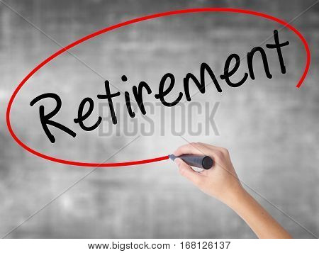 Woman Hand Writing Retirement With Black Marker Over Transparent Board