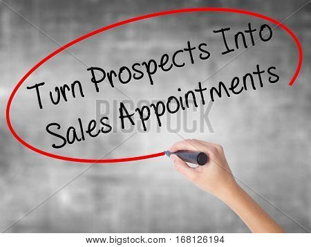 Woman Hand Writing Turn Prospects Into Sales Appointments  With Black Marker Over Transparent Board