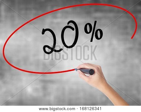 Woman Hand Writing 20% With Black Marker Over Transparent Board