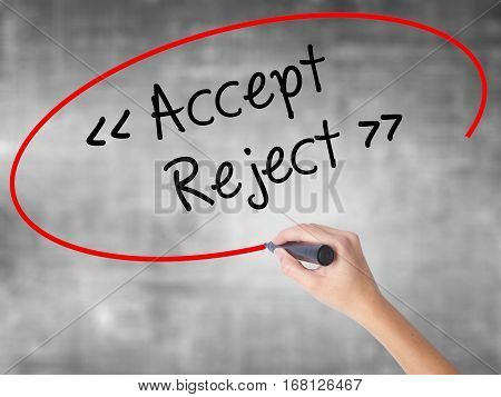 Woman Hand Writing Accept - Reject  With Black Marker Over Transparent Board.