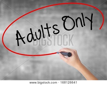 Woman Hand Writing Adults Only With Black Marker Over Transparent Board