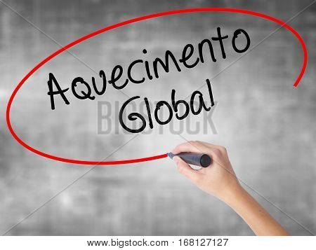 Woman Hand Writing Aquecimento Global (global Warming In Portuguese) With Black Marker Over Transpar