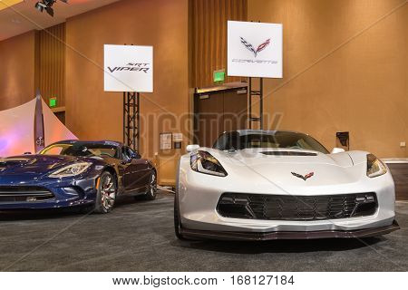 DETROIT MI/USA - JANUARY 11 2015: A SRT Dodge Viper GTS and a Chevrolet Corvette Z06 at The Gallery an event sponsored by the North American International Auto Show (NAIAS) and the MGM Grand Detroit.