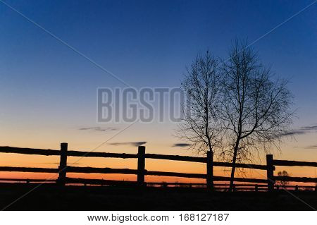 Dawn in the village fence. Morning in the village. Rustic fence at dawn