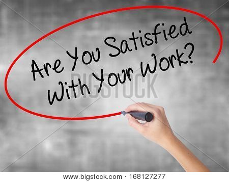 Woman Hand Writing Are You Satisfied With Your Work? With Black Marker Over Transparent Board