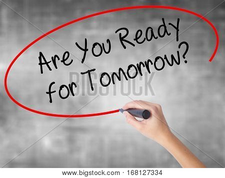 Woman Hand Writing Are You Ready For Tomorrow? With Black Marker Over Transparent Board.