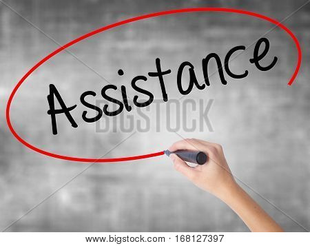 Woman Hand Writing Assistance With Black Marker Over Transparent Board