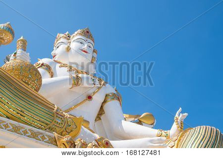 The Biggest Brahma and Guan yin on white clouds and blue sky background, in Wat Samanrattanaram Temple