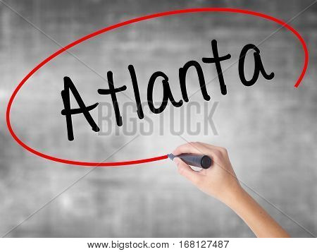Woman Hand Writing Atlanta With Black Marker Over Transparent Board