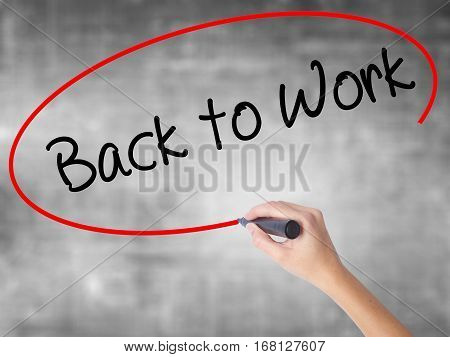 Woman Hand Writing Back To Work With Black Marker Over Transparent Board